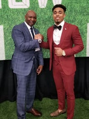 Jaire Alexander (right) shares a celebratory moment with former high school position coach Willie Crite Jr. at the 2018 NFL draft.