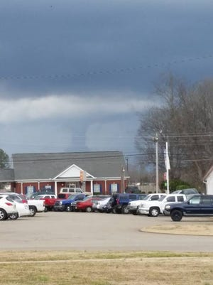 A funnel cloud was spotted behind the People's Bank in Henderson. No damage was reported.