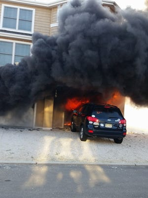 Firefighters battled a blaze that spread from a garage on Bay Terrace Saturday.