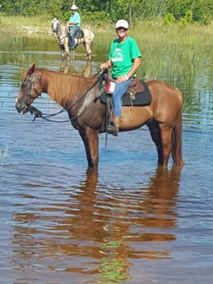 Fancy and her rescuer Tina Garrett had a great ride just hours before lightning killed the mare.