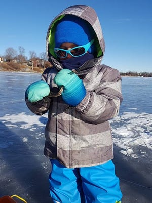 Henry Wood wears his winter exploring gear while on a lake near Lindstrom, MN.
