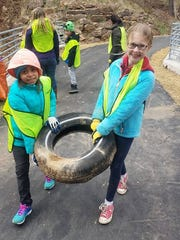 Young volunteers help with an Asheville GreenWorks litter cleanup.
