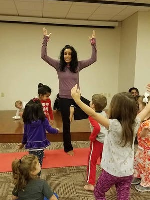 Children's yoga class with Ankita Roelofs at MOMS Club open house in Parsippany.