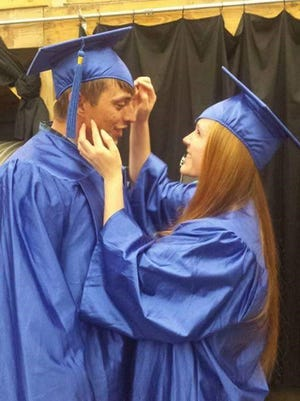 Houston Curry and girlfriend, Kara Messamore celebrate graduation as they receive their diplomas through the Adult Education Program in Union Co.