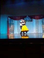 JC Carter and Debbra London perform the ballroom waltz