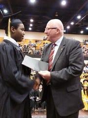 Robertson County Mayor Howard Bradley congratulates