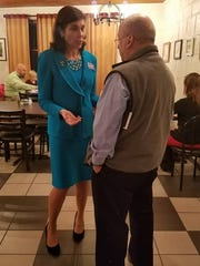 State Rep. Kristin Phillips-Hill talks to one of her
