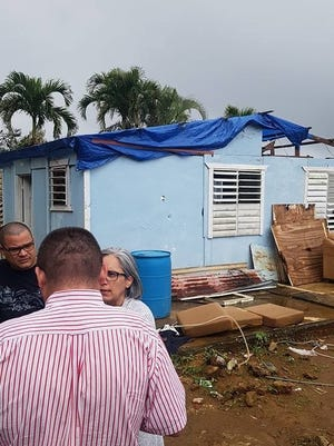 David Medina, left, and Gisela Rodriguez, bring supplies to Puerto Ricans who are still struggling in the aftermath of Hurricane Maria.