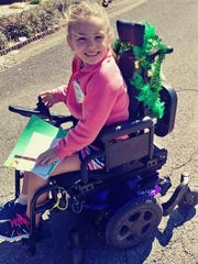 Kaylee's power wheelchair has helped her stay mobile between treatments.