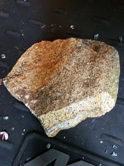 Rock thrown in Franklin woman's vehicle.