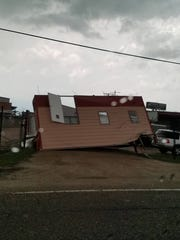 As storms moved through Lafayette Parish on Tuesday, strong winds caused damage to utilities and buildings.