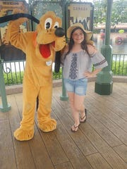 Emma Grant meets Pluto at Walt Disney World