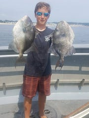 Justin Murphy of Toms River with a pair of triggerfish