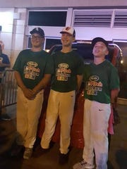Gavin McIntyre (middle) poses with Joel Cabrera from