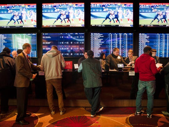 Gamblers place bets in the temporary sports betting area at the SugarHouse Casino in Philadelphia on Dec. 13.