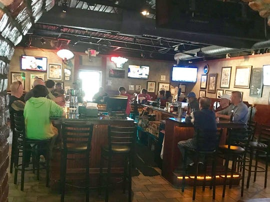 TVs surround the bar, so you can always find your game