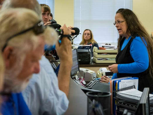 Rowan County Clerk Kim Davis, right, argues with David