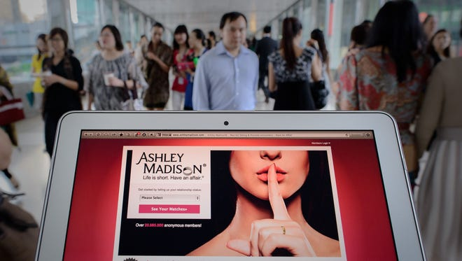 Philippe Lopez, AFP/Getty images This photo illustration shows the homepage of the Ashley Madison dating website displayed on a laptop in Hong Kong.