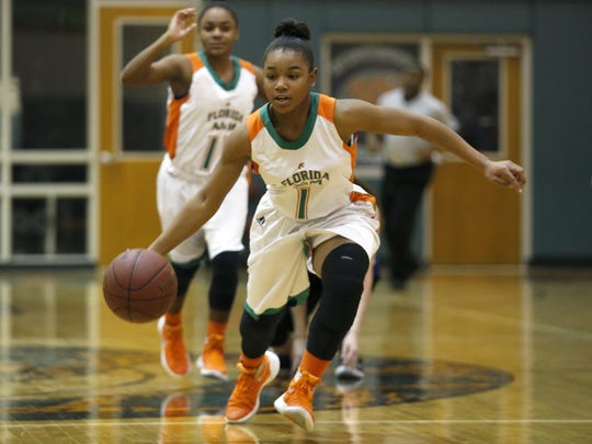 FAMU DRS seventh grader Erin Turral brings the ball up court against Hernando Christian during their Region 1-2A final on Saturday. Turral had 13 points and 10 rebounds in an 85-12 win.