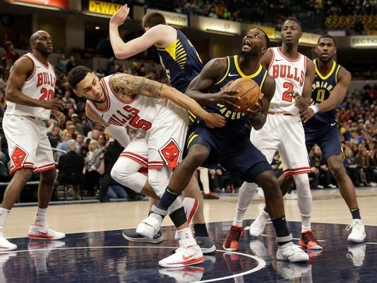 Indiana Pacers guard Lance Stephenson, right front, pulls down a rebound around Chicago Bulls forward Denzel Valentine during the second half of an NBA basketball game in Indianapolis, Saturday, Jan. 6, 2018. The Pacers won 125-86. (AP Photo/AJ Mast)