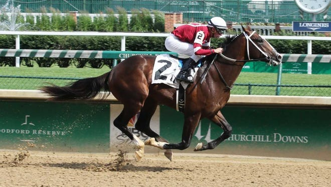 Copper Bullet, with Florent Geroux aboard, wins at Churchill Downs on May 25.