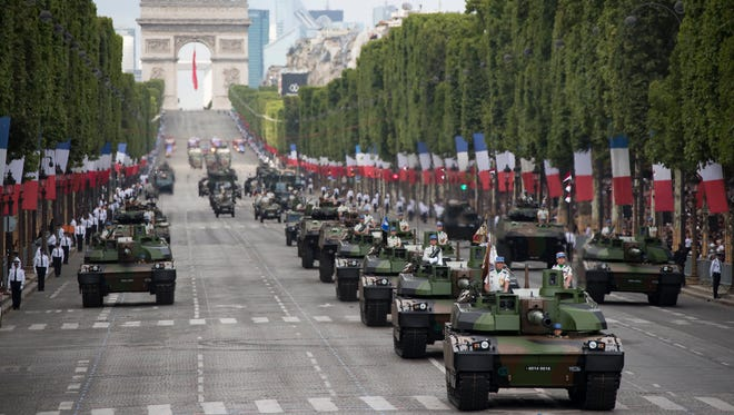French military tanks drive down the Champs-Elysees as they take part in the traditional military parade as part of the Bastille Day celebrations in Paris, France, on July 14, 2017. The Bastille Day, the French National Day, is held annually on 14 July to commemorate the storming of the Bastille fortress in 1789.