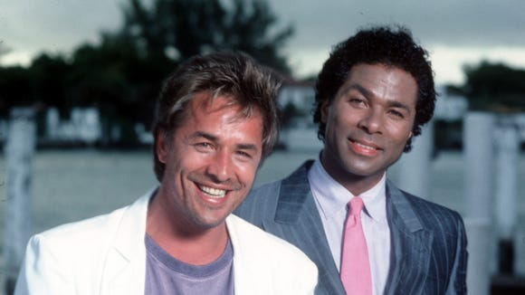 Don Johnson, left, and Philip Michael Thomas played glamorous cops in 'Miami Vice'.