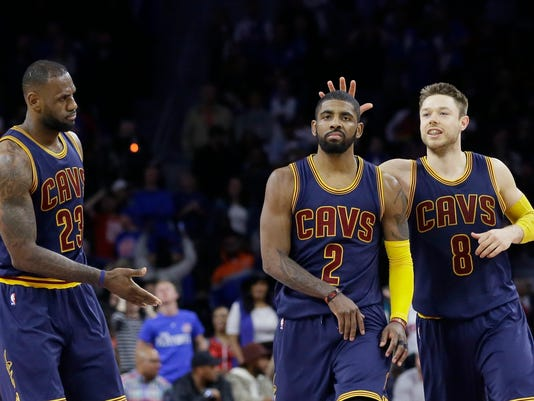 Cleveland Cavaliers guard Kyrie Irving (2) is congratulated by guard Matthew Dellavedova (8) and forward LeBron James (23) after a 3-point basket during the second half in Game 4 of a first-round NBA basketball playoff series, Sunday, April 24, 2016 in Auburn Hills, Mich. The Cavaliers defeated the Pistons 100-98 and swept the series. (AP Photo/Carlos Osorio)