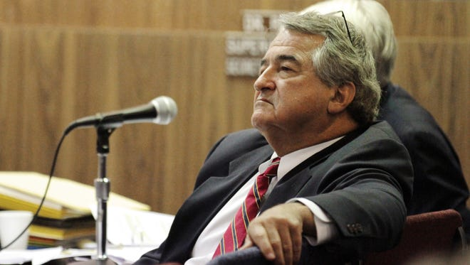 Pat Cooper listens to testimony during his termination hearing in November 2014. The school board is now appealing a court decision to award damages to Cooper.