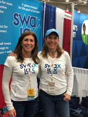 Swax Lax Director of Operations Betsy Vreeland of Short Hills and Inventor and President Laura Gump of Summit pose at their LaxCon 2018 booth.