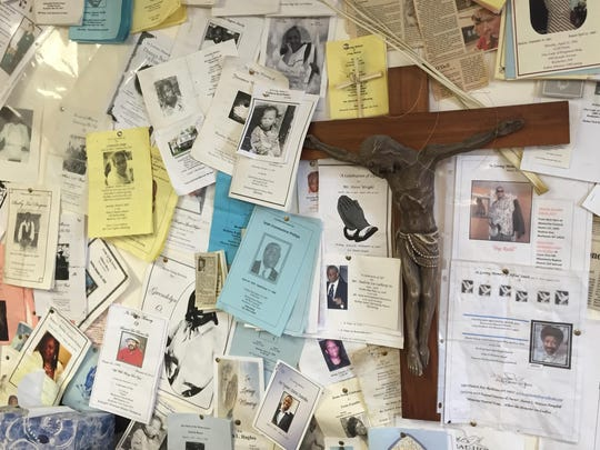 A wall of Sister Grace Miller's office is covered in funeral programs for poor people she has helped bury.