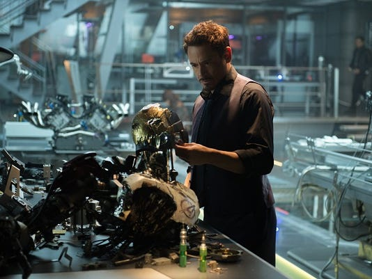 """This photo provided by Disney/Marvel shows, Robert Downey Jr. as Iron Man/Tony Stark in the new film, """"Avengers: Age Of Ultron."""" The movie releases in U.S. theaters on May 1, 2015. (Jay Maidment/Disney/Marvel via AP)"""