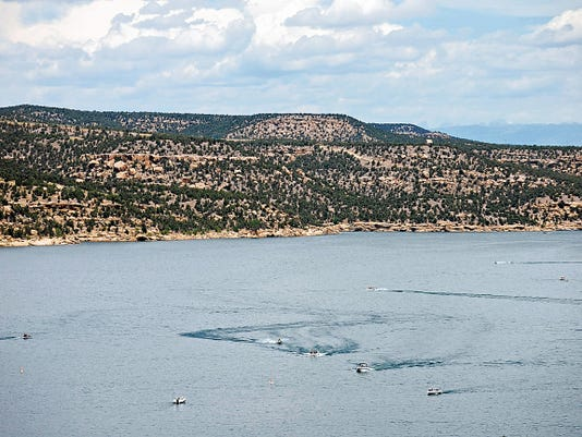 Motor boats dot Navajo Lake on July 11. Many residents say Farmington's proximity to several major bodies of water makes it an ideal place for paddle sports.