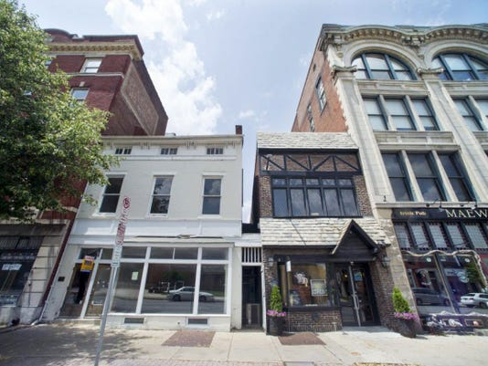 The white building, seen in this 2014 file photo, is the future site of The Handsome Cab, a wine bar and art gallery, that will be located in the former Formpress building at 106 N. George St. in York. York City Council approved a liquor license transfer for the wine bar at Wednesday's council meeting.