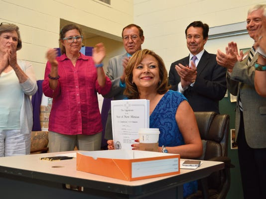 """Anthony Albidrez - Sun-News   Gov. Susana Martinez signs a 294 million capital spending bill into law Wednesday at St. Luke's Clinic in Las Cruces. She is joined by, from left, Pamela Angell, executive director of St. Luke's; state Rep. Bealquin """"Bill"""" Gomez, D-La Mesa; Jon Barela, secretary of the state Economic Development Department; and state Sen. Ron Griggs, R-Alamogordo. St. Luke's is a recipient of 500,000 in capital outlay funds."""