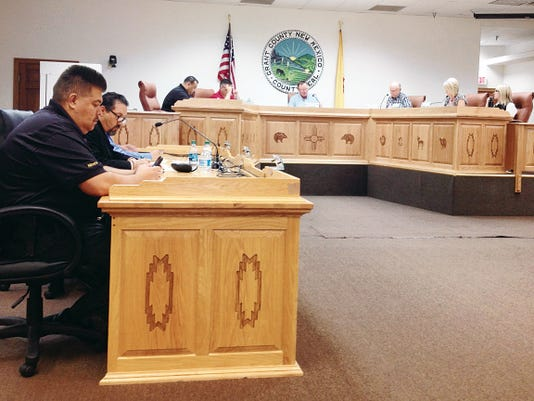 Grant County Sheriff Raul Villanueva, left, and County Assessor Raul Turrieta prepare to deliver their reports to the County Commissioners during the board work session on Tuesday in Silver City. Randal Seyler - Sun-News