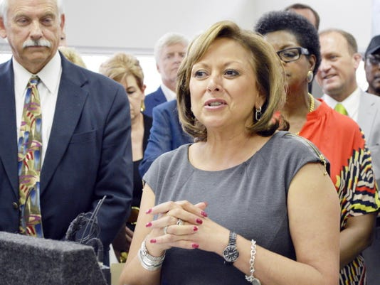 New Mexico Gov. Susana Martinez speaks to business leaders on June 15 at the Bioscience Center in Albuquerque before signing a bill on a set of tax incentives passed by lawmakers during a special session. Martinez said the measure would help attract businesses to the state.