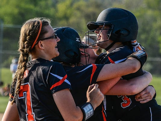 Central York teammates hug Kayla Resh after her game-winning RBI single in the bottom of the seventh inning on Monday vs. Dallastown. Central won the game, 5-4, and also claimed the York-Adams Division I title.