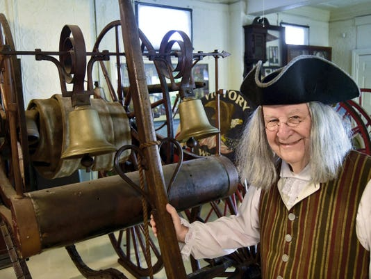 Bob Harrison as inventor Ben Franklin checks out vintage fire equipment July 31 at the Chambersburg Volunteer Fireman's Museum. Franklin is credited with developing the American fire company system and fire insurance concept.