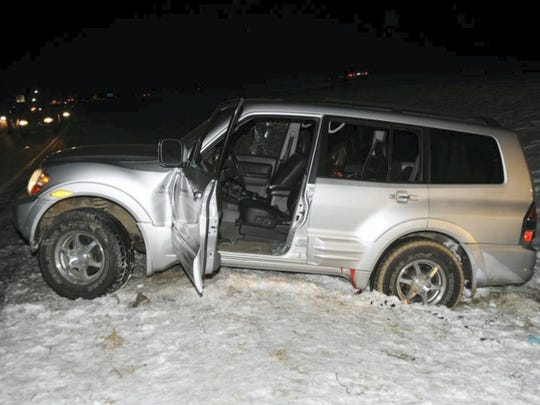 This police photo shows the vehicle driven by Timothy Davison on Jan. 4, 2014, crashed into a median after another motorist — who police have identified as John Wayne Strawser — allegedly ran him off the road before fatally shooting him. The crime raised fears and questions from the community as to the identity of the shooter and whether it was a random act or specifically directed at Davison.