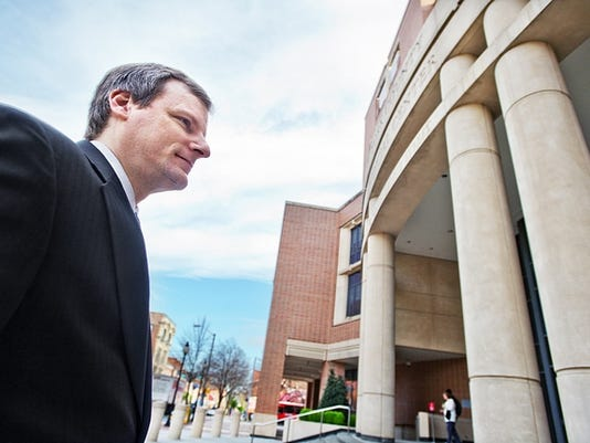 York Councilman Michael Helfrich enters the York County Judicial Center Wednesday for a hearing that could determine he fate of his seat on council. Helfrich pleaded guilty to two felony drug charges in 1991.