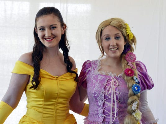 The Enchanted Teapot provides princesses and characters for parties. Here, Hannah Kirsch portrays Belle and Grace Nale portrays Rapunzel.