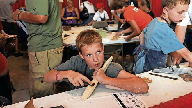 KidVenture features airplane-themed activities throughout the event.