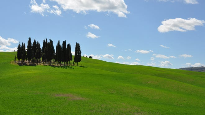Much of the Tuscan countryside is a confection of green hills and blue sky.