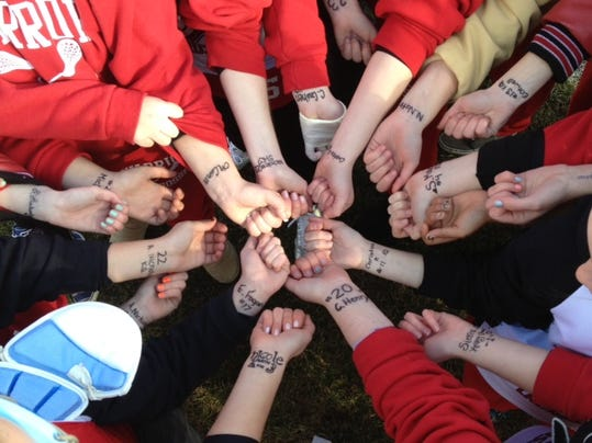 The Susquehannock High School Girls' Lacrosse team gather before the game and show their support for the Seton Hill victims