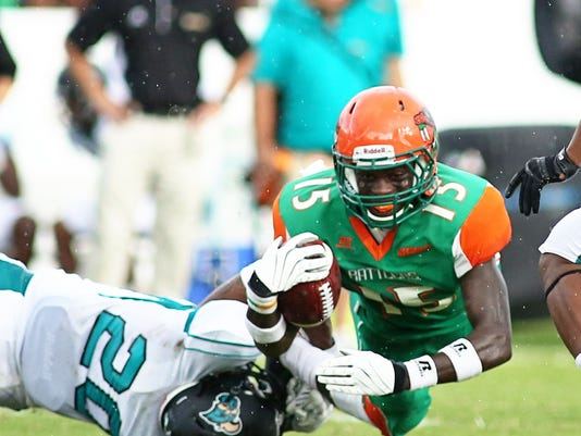 Montavious Williams is tackled by Kamron Summers.jpg