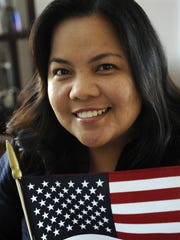 Lyn Mae Teves Alvarez, 38, of Visalia became an American citizen in 2013. She's holding the flag she carried when she took the Oath of Citizenship.