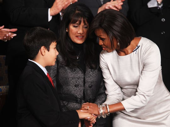 First lady Michelle Obama greets Dallas Green (left)