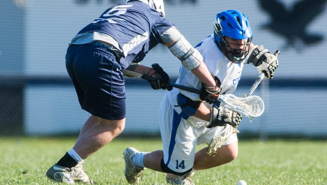 Stephen Decatur FOGO Dryden Brous (14) takes a face-off against St.'s Peter and Paul at Seahawk Stadium in Berlin on Monday, March 21.