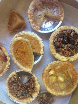 """Sweet Creations makes pies in six flavors: pecan, sweet potato, peach, apple, chocolate chip pecan and """"jus"""" (Tom's take on chess), all available in 3-inch and 9-inch versions."""